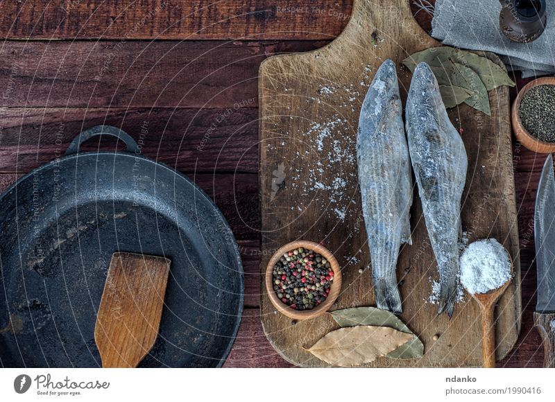 Frozen fish smelt on the kitchen board Nature Eating Wood Food Brown Above Metal Nutrition Fresh Table Fish Herbs and spices Ground Kitchen Knives