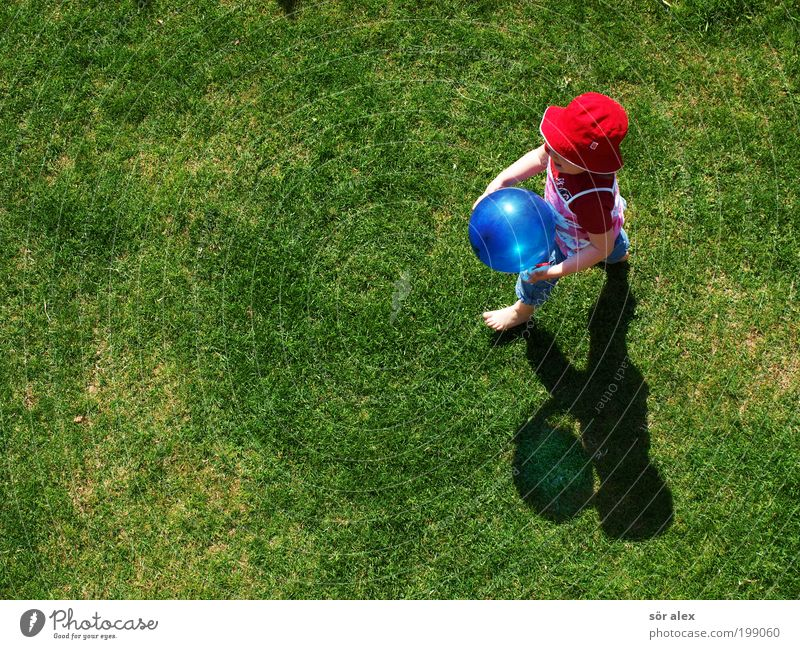 Got the balloon'g Playing Toddler Girl Infancy 1 Human being Spring Beautiful weather Grass Garden Meadow T-shirt Jeans Cloth Hat Balloon Going Smiling Laughter