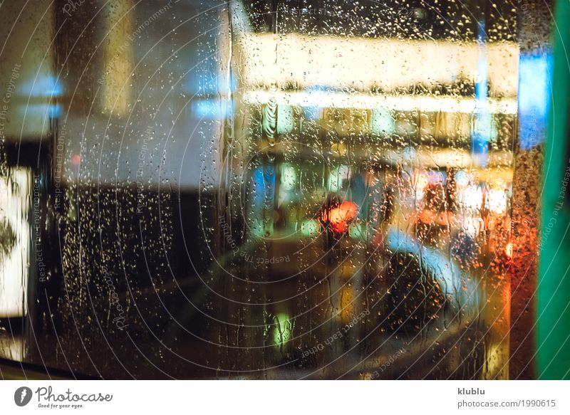 Wet with rain street through the glass of the bus. Life Vacation & Travel Weather Rain Transport Street Vehicle Movement Modern Vantage point sign Illuminate