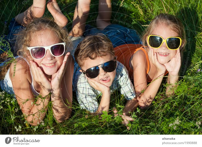 Three happy children playing in the park at the day time. Human being Child Nature Vacation & Travel Summer Beautiful Green Joy Girl Face Lifestyle Love Meadow