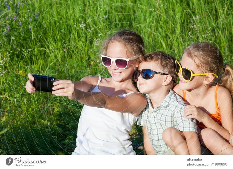 Three happy children playing in the park at the day time. Human being Child Nature Vacation & Travel Summer Beautiful Green Joy Girl Face Lifestyle Love Meadow Grass Boy (child) Family & Relations