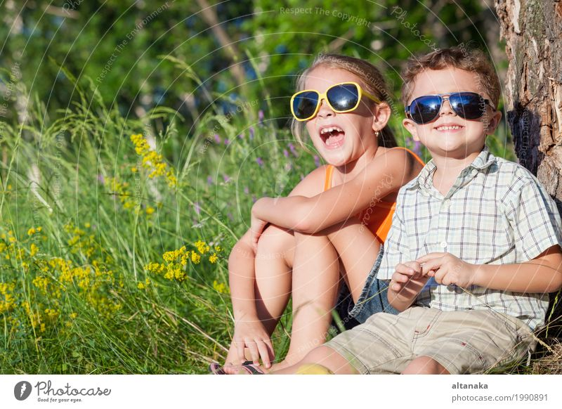 Two happy children playing near the tree at the day time. Human being Child Nature Vacation & Travel Summer Beautiful Green Joy Girl Face Lifestyle Love Meadow