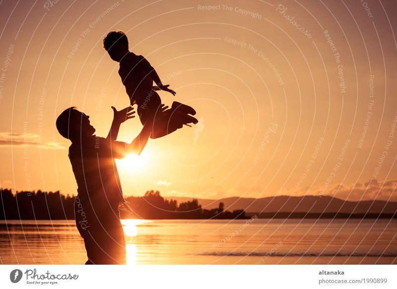 Father and son playing at the sunset time. Lifestyle Joy Happy Leisure and hobbies Vacation & Travel Adventure Freedom Camping Summer Sun Beach Mountain Hiking