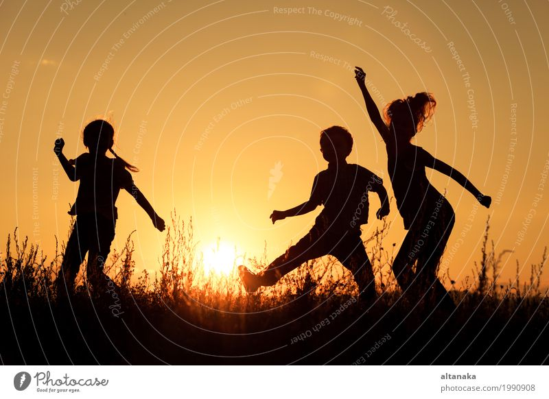 Happy children playing in the park Child Woman Sky Nature Vacation & Travel Summer Sun Hand Joy Girl Adults Lifestyle Love Sports Grass Boy (child)