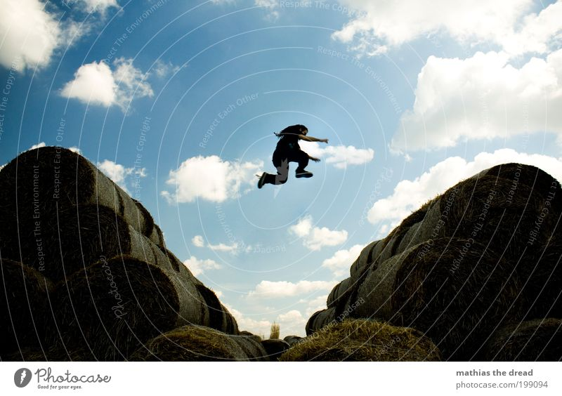 Human being Sky Nature Youth (Young adults) Plant Summer Clouds Adults Environment Landscape Jump Style Field Leisure and hobbies Flying Elegant