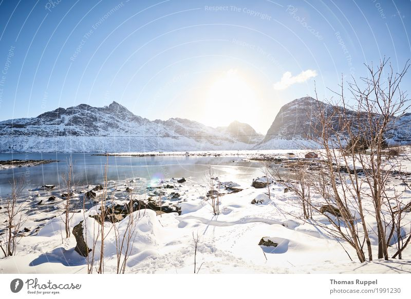 Nature Vacation & Travel Blue White Sun Landscape Far-off places Winter Mountain Black Environment Snow Freedom Tourism Gray Lake