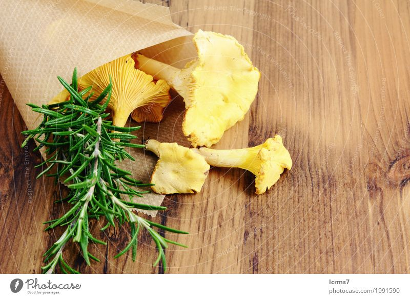 paper bag with golden chanterelle and rosemary spice Healthy Eating Fresh Brown Yellow Green chantarelle food natural mushrooms organic tasty vegetable
