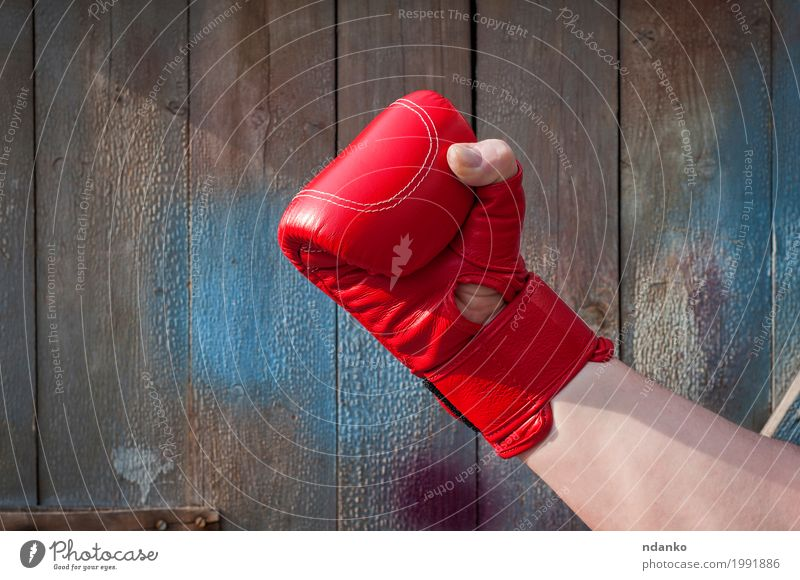 Man's hand in red boxing gloves Human being Old Blue Hand Red Adults Sports Wood Body Retro Power Success Fingers Fitness Strong