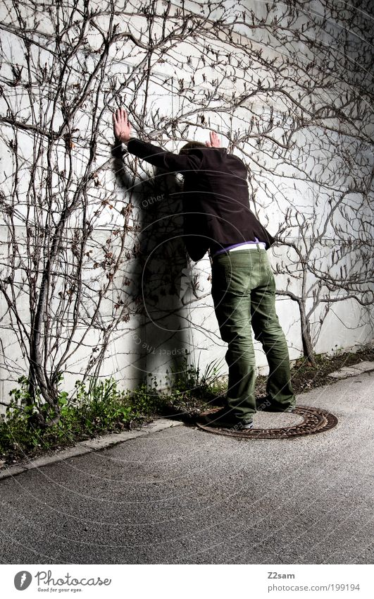 Youth (Young adults) Plant Street Dark Wall (building) Gray Adults Style Wait Masculine Stand Bushes Threat Might Touch Munich