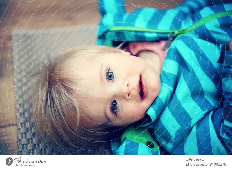 Looking at you Child Toddler Girl Sister 1 Human being 1 - 3 years Part Observe Lie Esthetic Positive Beautiful Blue Happy Happiness Contentment Anticipation