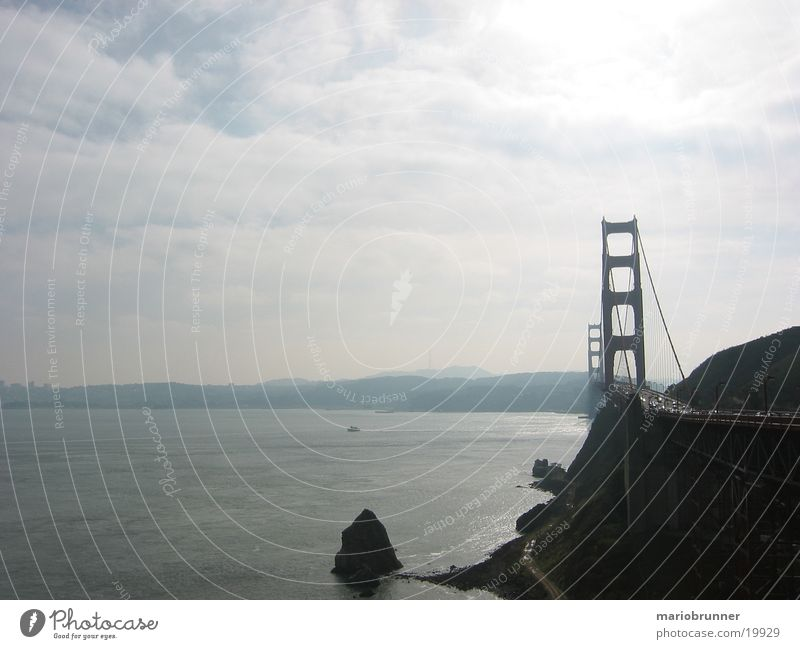 Ocean Far-off places Coast Rock Bridge USA Vantage point Travel photography Highway California Clouds in the sky San Francisco Vacation photo Suspension bridge
