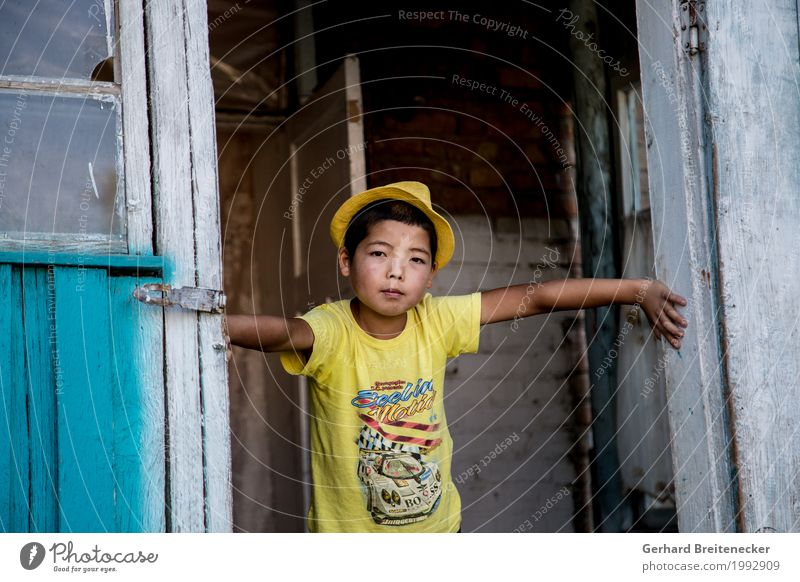 yellow fellow Child Boy (child) Infancy 1 Human being 8 - 13 years Bishkek Kyrgyzstan Asia Asians Village T-shirt Hat Poverty Authentic Cool (slang) Dirty Dark