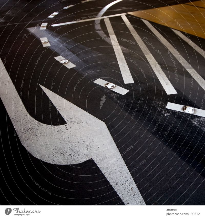 U-Turn Design Trip Town Transport Traffic infrastructure Crossroads Road sign Parking garage Sign Line Arrow Stripe Dark Mobility Curve Dynamics Colour photo