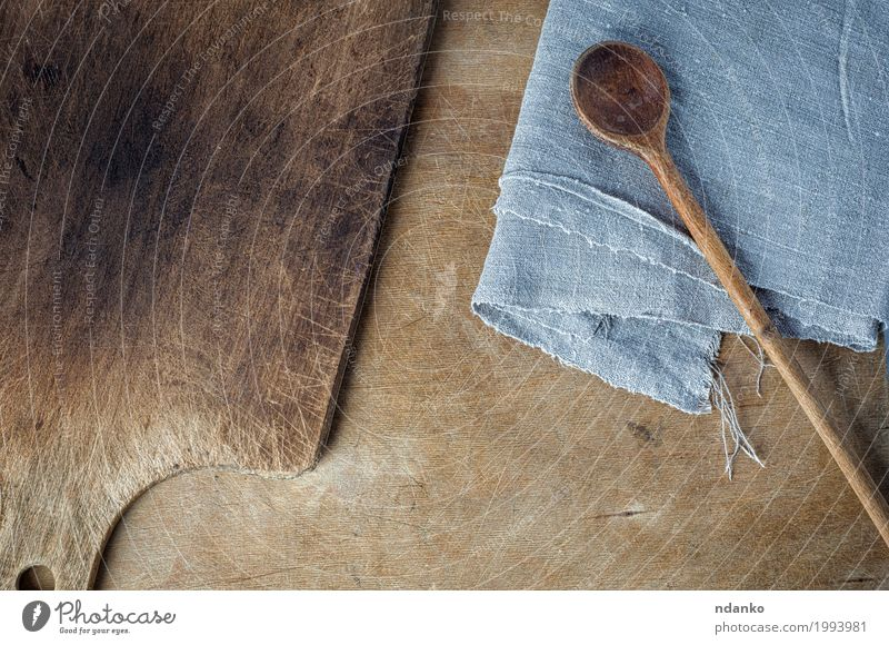 cutting board and a wooden spoon on the table Spoon Table Kitchen Wooden spoon Old Above Brown Gray cook empty space background Shabby housewares Home textile