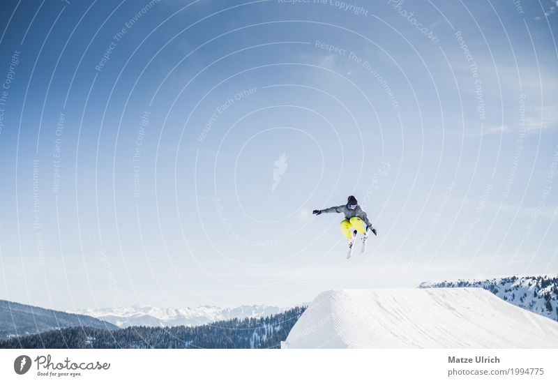 Human being Youth (Young adults) Young man Winter Mountain Snow Flying Leisure and hobbies Masculine Peak Alps Snowcapped peak Cloudless sky Skis Glacier