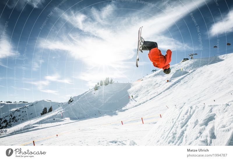 Human being Youth (Young adults) Young man Red Winter Mountain Snow Sports Rock Flying Leisure and hobbies Jump Masculine Ice Peak Hill