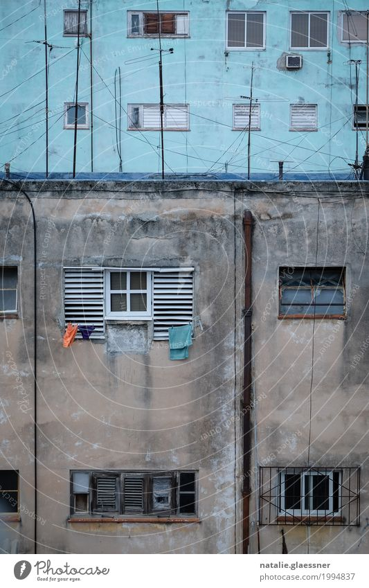 clothesline Capital city Downtown High-rise Wall (barrier) Wall (building) Facade Window Poverty Simple Blue Orange Colour photo Exterior shot Copy Space bottom