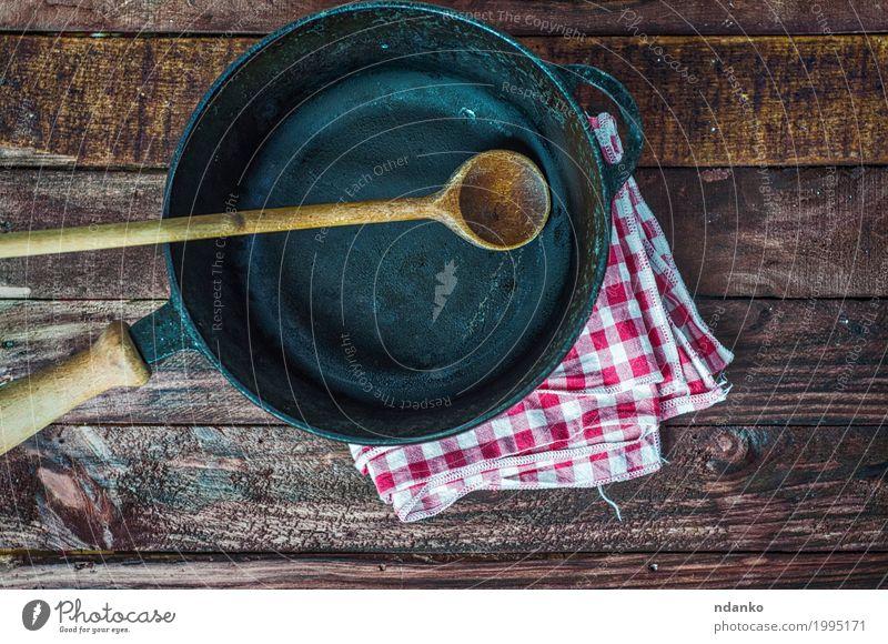 Empty black cast-iron frying pan Crockery Pan Spoon Design Table Kitchen Restaurant Cloth Wood Metal Above Clean Brown Black tableware Tablecloth spatula