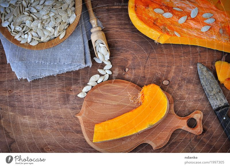 Piece of fresh pumpkin and pumpkin seeds White Eating Yellow Wood Food Brown Above Nutrition Fresh Vantage point Table Herbs and spices Kitchen Vegetable