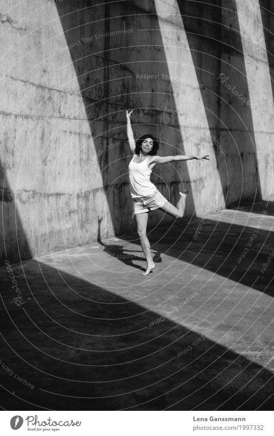 Woman dances in front of geometric shadows on concrete Athletic Fitness Meditation Playing Summer Summer vacation Sun Sports Training Track and Field Yoga Dance