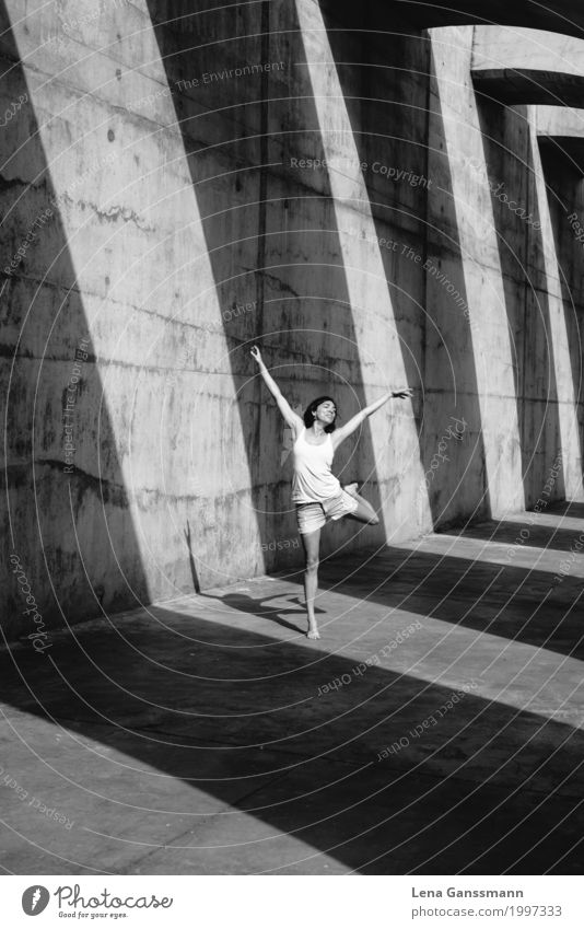Woman dances in front of geometric shadows on concrete Style Personal hygiene Athletic Dance Feminine Young woman Youth (Young adults) Adults Body 1 Human being