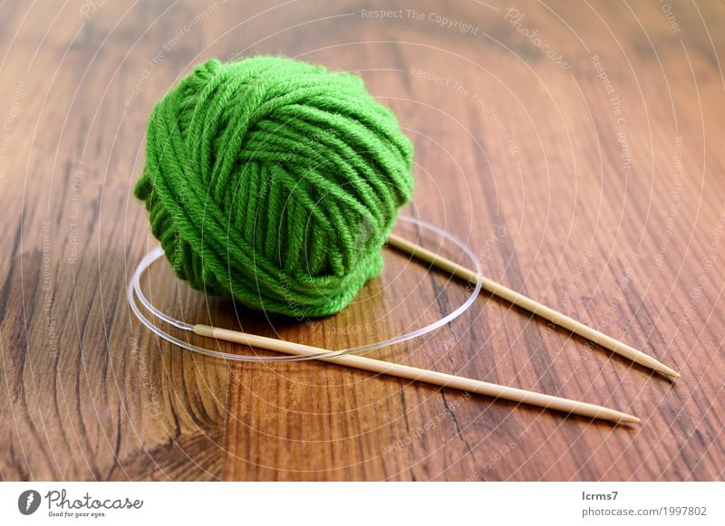knit needles and wool on table. knitting. Leisure and hobbies Warmth Fashion Wool Knit Creativity creased yarn handmade The Needles Background picture woolen
