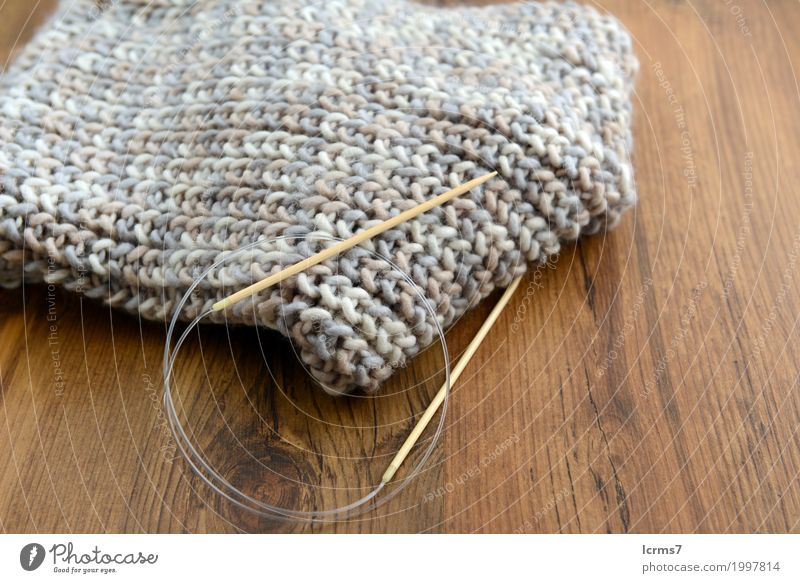 knitting grey scarf. Leisure and hobbies Warmth Fashion Scarf Knit Wool Creativity creased yarn handmade needle The Needles Background picture woolen thread