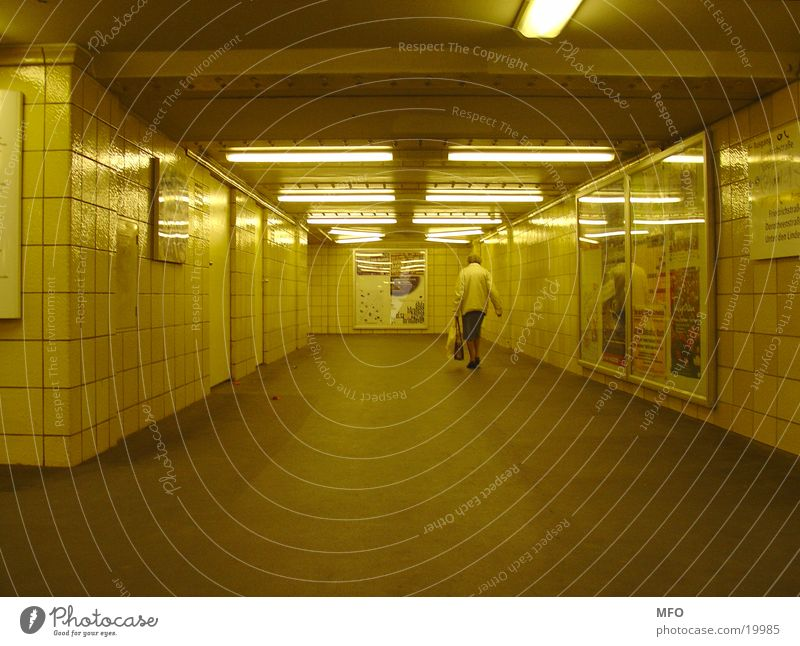 Pensioner in the Berlin underground tunnel Senior citizen Underground Tunnel London Underground Architecture Female senior Light artificial world