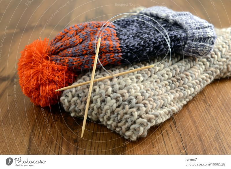 knitting scarf and woolly has Leisure and hobbies Warmth Fashion Wool Knit Cap Creativity creased yarn handmade needle The Needles Background picture woolen