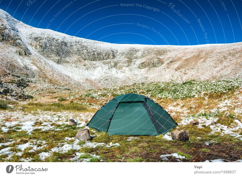 Green tent on the green lawn in snow mountains Sky Nature Vacation & Travel Plant Blue Colour Green White Landscape Winter Mountain Environment Yellow Lifestyle Spring Snow
