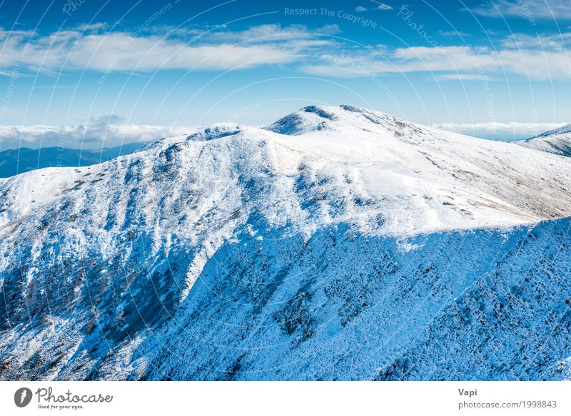 White peaks of mountains in snow Sky Nature Vacation & Travel Blue White Sun Landscape Clouds Winter Mountain Yellow Snow Tourism Rock Hiking Ice