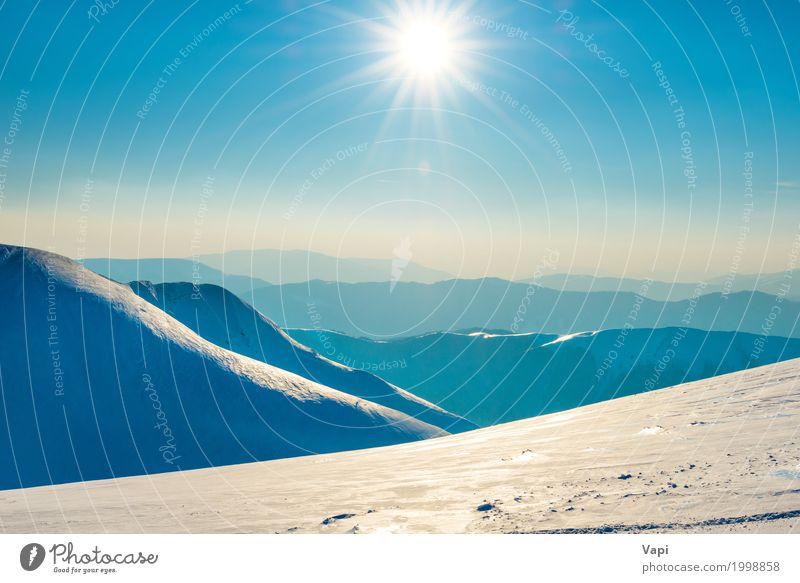 Bright sun in winter mountains Sky Nature Vacation & Travel Blue White Sun Landscape Winter Mountain Environment Yellow Natural Snow Orange Horizon Fog