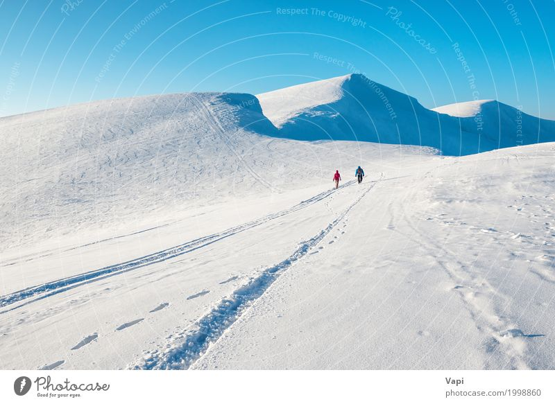 Two people in beautiful winter mountains Human being Woman Sky Nature Vacation & Travel Man Blue White Landscape Clouds Winter Mountain Adults Lanes & trails Snow Freedom