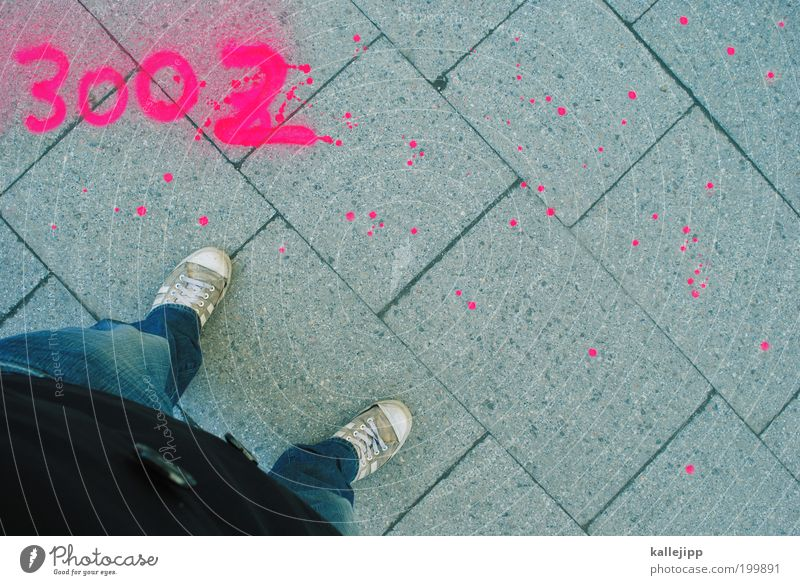 stand Lifestyle Human being Man Adults Legs Feet 1 Jeans Jacket Sneakers Sign Digits and numbers Graffiti Stand Modern Spray 3002 Paving tiles Colour photo