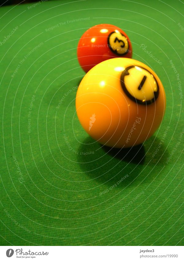 Two friends Leisure and hobbies Pool (game) Digits and numbers Green Billard bowle Yellow Colour photo Multicoloured Interior shot Close-up Detail