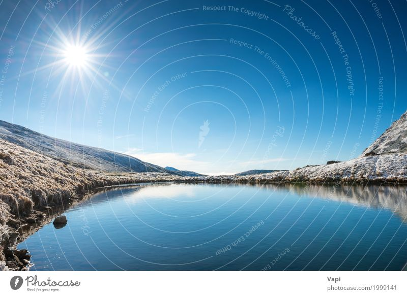 Beautiful blue lake in the mountains Vacation & Travel Tourism Summer Sun Winter Snow Mountain Environment Nature Landscape Water Sky Cloudless sky Horizon