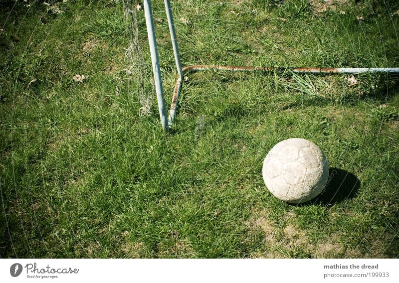 Old Green Sports Playing Dirty Foot ball Gloomy Round Lie Leisure and hobbies Grass surface Derelict Rust Goal Leather