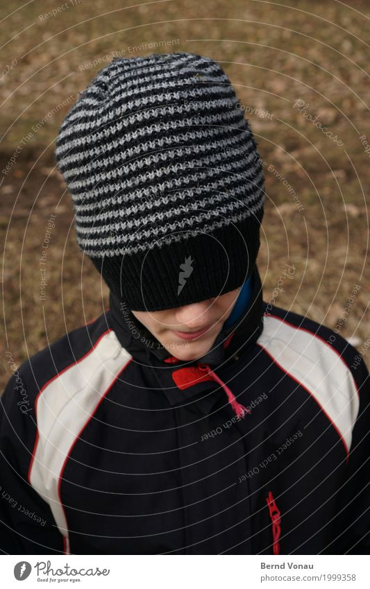 Monday cap Human being Child Head 1 Smiling Looking Hide Masked Face Cap Jacket Black Red Blind Playing Unidentified Stripe Striped Colour photo Exterior shot