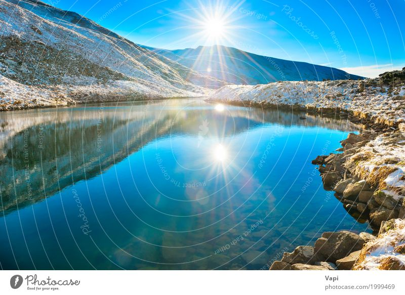 Beautiful blue lake in the mountains, morning sunrise time Sky Nature Vacation & Travel Blue Summer Water White Sun Landscape Winter Beach Mountain Black Environment Yellow Autumn