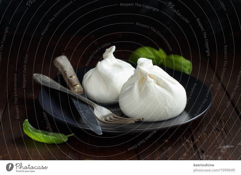 Italian cheese burrata with fork and knife Cheese Dairy Products Nutrition Italian Food Wood Dark Fresh Delicious Soft White appetizer Apulia background cream
