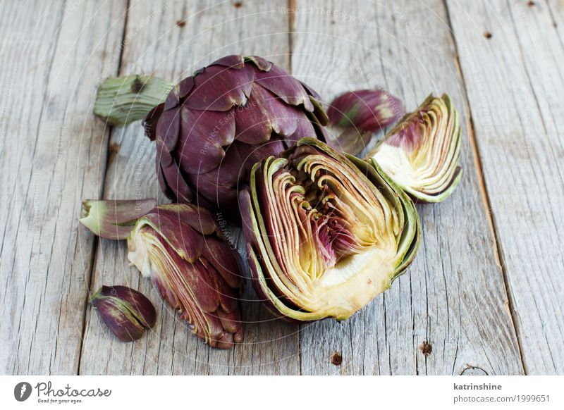 Roman Artichokes on a wooden board Vegetable Nutrition Vegetarian diet Fresh Gray Green agriculture Purple cooking Cut Edible food Half Ingredients