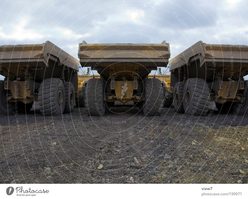dump truck Construction site Logistics Earth Bad weather Storm Transport Street Truck Site trailer Sign Aggression Threat Dirty Dark Sharp-edged Large Cold