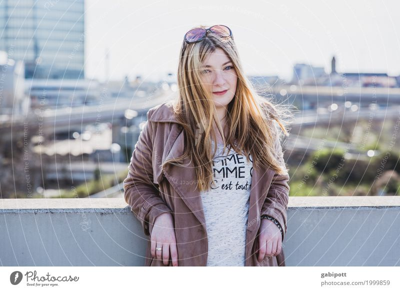 young woman against urban background Lifestyle pretty Personal hygiene Hair and hairstyles Human being Feminine Young woman Youth (Young adults) Woman Adults 1