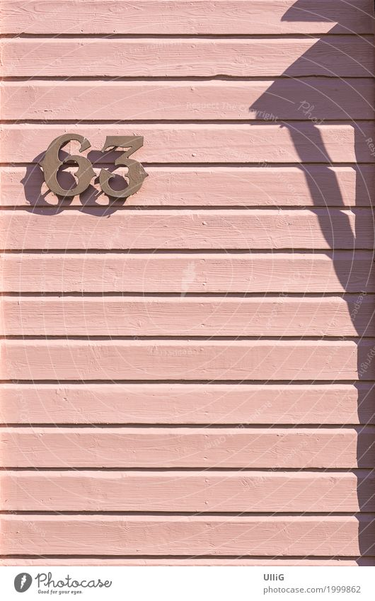 House number 63 on a pink board wall. House (Residential Structure) Architecture Wall (barrier) Wall (building) Digits and numbers Pink gnothimage Panels
