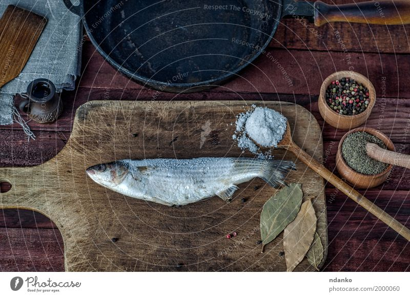 Frozen fish smelt on a kitchen cutting board Black Eating Wood Food Brown Above Metal Nutrition Fresh Table Fish Herbs and spices Kitchen Top Diet Spoon