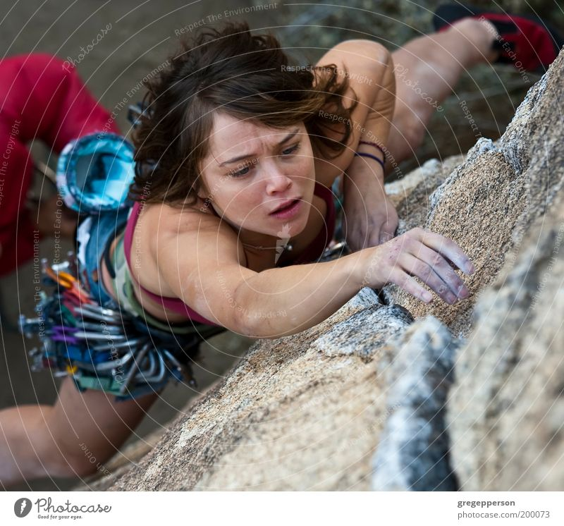 Female rock climber. Human being Youth (Young adults) Loneliness Sports Adults Tall Adventure Rope Dangerous Direction Climbing Woman Athletic 18 - 30 years Hang Risk