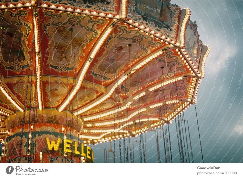 funfair Leisure and hobbies Illuminate Stand Wait Old Bright Historic Beautiful Fairs & Carnivals Carousel Chairoplane Fairy lights Entertainment Infancy