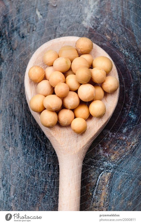Soy beans on wooden spoon and wooden table Healthy Natural Wood Nutrition Fresh Grain Organic produce Vegetarian diet Spoon Raw Ingredients Vegan diet Beans