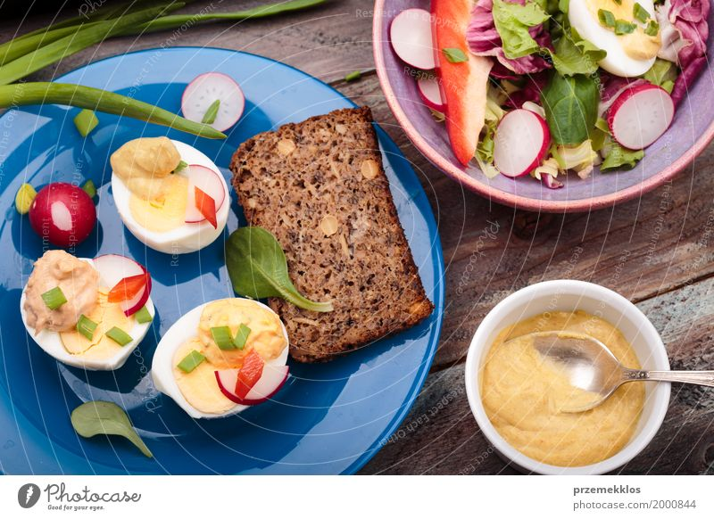 Healthy meal with eggs and vegetables Food Vegetable Lettuce Salad Bread Lunch Vegetarian diet Diet Bowl Healthy Eating Table Wood Fresh Meal mustard overhead