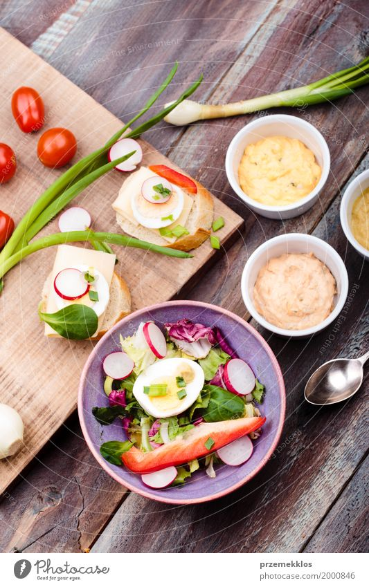 Healthy meal with eggs and vegetables Food Vegetable Lettuce Salad Bread Lunch Vegetarian diet Diet Bowl Table Wood Fresh Delicious healthy Meal mustard